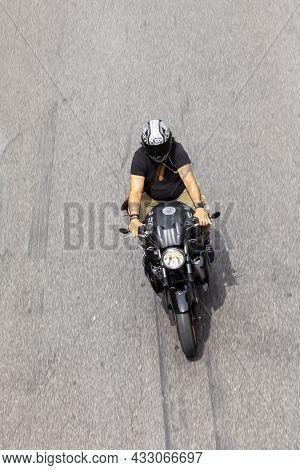 Rome, Italy - August 4, 2021: People On Motorbike In Rome In Areal View. Many People In Rome Use Mot