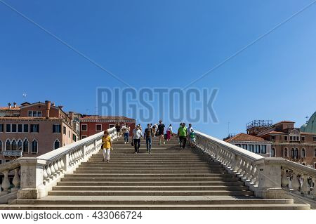 Venice, Italy - July 2, 2021: People Crossing Grand Canal At Ponte Degli Scalzi Near Luca Railway St