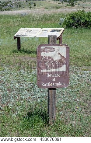 Madison Buffalo Jump Sp , Mt, Usa - July 2, 2020: A Warning Sign In Case Of Snake Sighting
