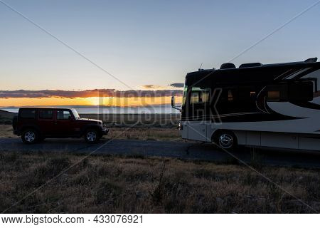 The Famous Off-road Vehicle Side By Side With A Motorhome In Antelope Island Sp, Utah