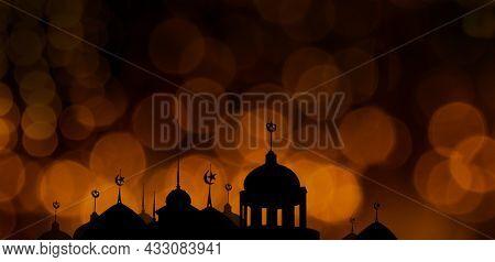 Ramadan Kareem Religion Symbols. Mosques Dome In Twilight Night With Orange Bokeh Light Night Dark B
