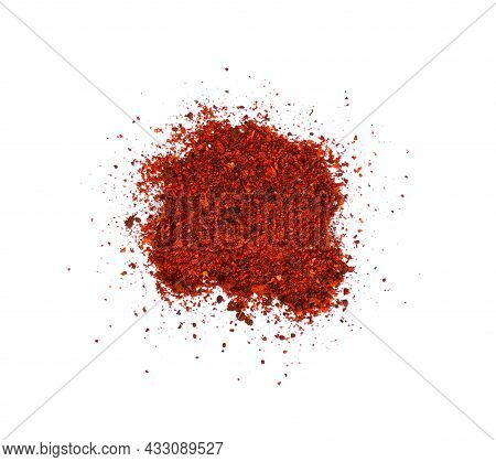 Close Up Heap Of Ground Sundried Tomatoes Spilled, Isolated On White Background, Elevated Top View,