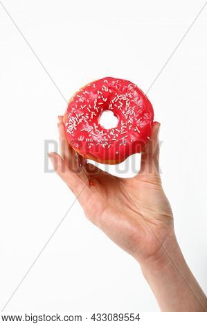 Close Up Caucasian Woman Hand Holding One Red Icing Glazed Ring Doughnut Isolated On White Backgroun
