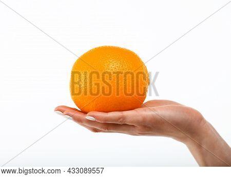Close Up Caucasian Woman Hand Holding One Fresh Orange Fruit Isolated On White Background, Symbol Of