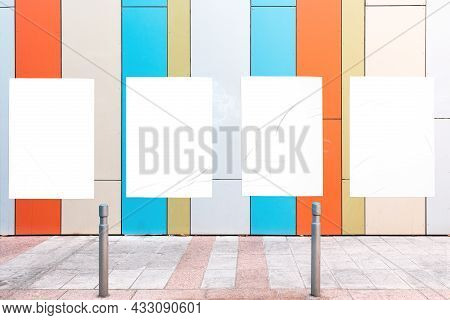 Modern Urban Scene With Colorful Geometrical Wall And Four White Glued Wrinkled Poster Templates. Mo
