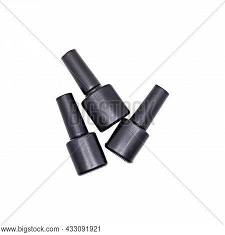 Three Black Bottles Of Gel Nail Polish Isolated On White Background, Image For Advertising Nail Poli