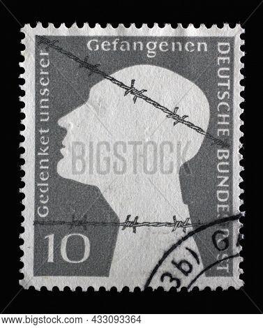 ZAGREB, CROATIA - JUNE 25, 2014: Stamp printed in Germany, shows Memorial Edition of War Prisoners, Prisoner behind barbed wire, circa 1953