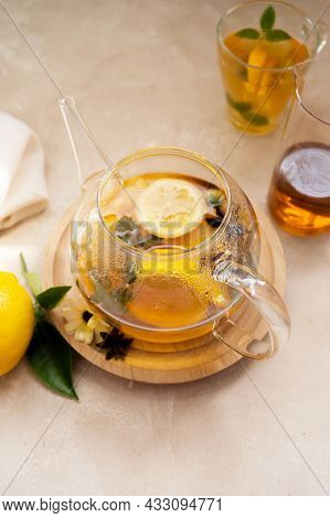 Glass Tea Pot With Fruit Delicious Herbal Tea, Bright Background.