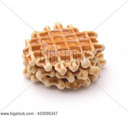 Stack of freshly baked homemade belgian waffles with honey isolated on white