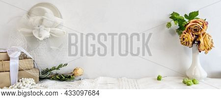 Fashionable White Stock Background With A Blank Photo Frame And Flowers. Blank For A Postcard. Femal