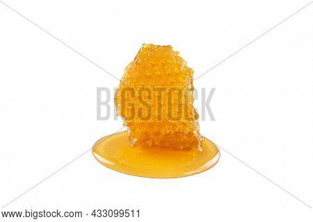Sweet Honey And Honeycomb. Healthy Organic Honey And Slice Of Honeycomb Isolated On White Background