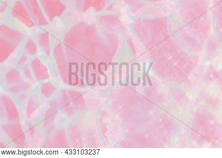 Sparkling iridescent holographic pink background with text space