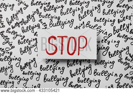 Composition With Text Stop Bullying On White Background, Top View