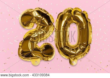 The Number Of The Balloon Made Of Golden Foil, The Number Twenty On A Pink Background With Sequins.
