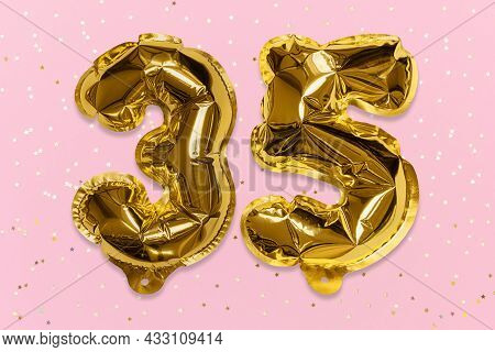 The Number Of The Balloon Made Of Golden Foil, The Number Thirty-five On A Pink Background With Sequ