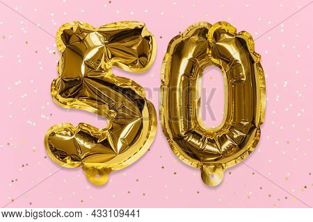 The Number Of The Balloon Made Of Golden Foil, The Number Fifty On A Pink Background With Sequins. B