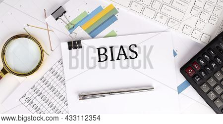 Bias Text On The White Paper On Light Background With Charts Paper ,keyboard And Calculator