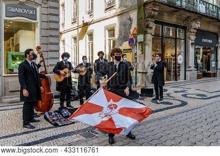 Porto, Portugal - September 11, 2021: Street Musicians In Medical Masks Perform On A Central Street