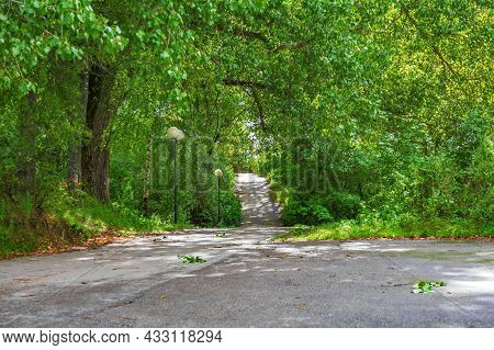Narrow Asphalt Road In Europe On A Sunny Day