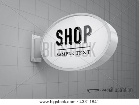 Blank, oval shop sign hanging on a wall
