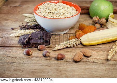 Healthy Vegetarian Breakfast, Oat Flakes, Nuts And Fruit In Diet
