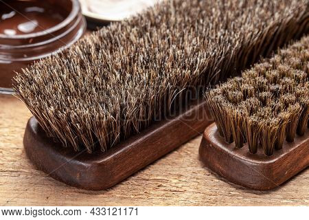 Brush For Shoes. Cleaning And Polishing Shoes With Brushes. Shoe Polish And Brush On Wooden Backgrou
