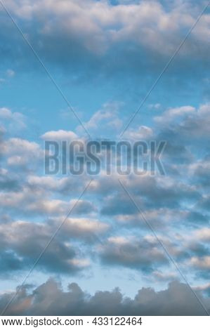 Cloudy Sky In Blue And Gray Clouds. Heavenly Background. Vertical Photo.