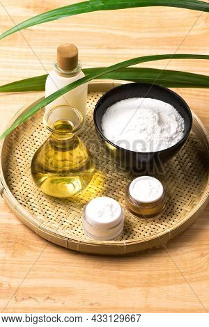 Rice Bran Oil Extract And Brown Rice On Wood Table Background.