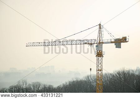 Construction Crane On Background Of Gray Sky. Steel Frame Structure, Structural Steel Beam Create La