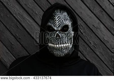 Halloween Holiday Concept. Death Carnival Costume. Scary Death Portrait. Death Mask On Black And Whi