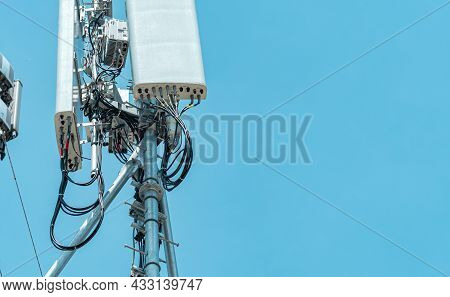 Telecommunication Tower With Clear Blue Sky Background. The Antenna Against The Blue Sky. Radio And