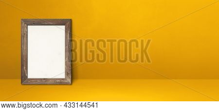 Wooden Picture Frame Leaning On A Yellow Wall. Blank Mockup Template. Horizontal Banner