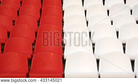 Rows Of Identical White And Red Seats In The Empty Stadium