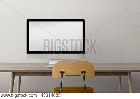 Computer with blank screen on a desk minimal home office zone design