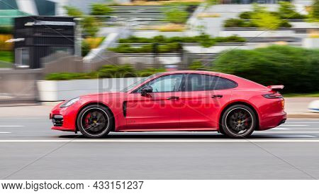 Moscow, Russia - August 2021: Red Car Porsche 971 Panamera At The City Street. Panamera Gts Fast Mov