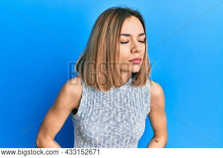 Young caucasian blonde woman wearing casual t shirt with hand on stomach because indigestion, painful illness feeling unwell. ache concept.