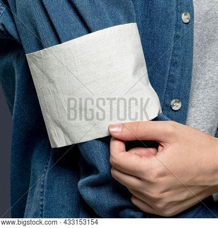 White volunteer armband on jeans sleeve