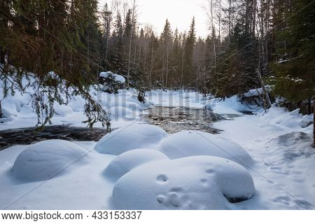 Snowdrifts On The Bank Of A Non-freezing River In A Winter Snowy Forest. Winter Landscape, Karelia