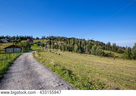 Dirt Road In The Silesian Beskids, Mountain Landscape With Small Village Near Wisla In Poland
