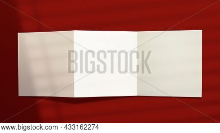 Tri-fold brochure with design space on red background