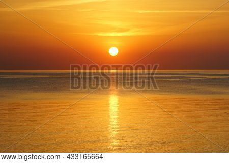 Beautiful Sunset In The Baltic Sea, Sun Above The Horizon With Reflection In The Water