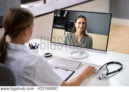 Doctor In Video Conference Call With Sick Patient