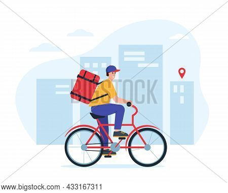 Delivery Man Or Courier On Bycicle In City. Express Food Delivery Concept. Smiling Boy With Big Parc
