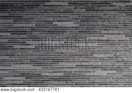Facing Decorative Gypsum Tile On Wall. Surface With Texture.