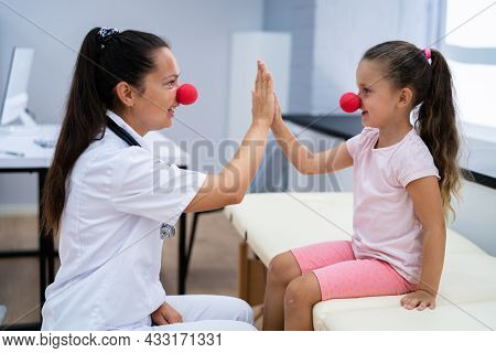 Kid And Pediatric Doctor High Five. Child Physician