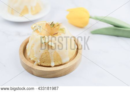 Homemade Lemon Cake Classic Recipe, Decorated With Sugar Icing On Marble Table. Healthy Organic Summ