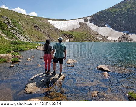 Young Couple On Shore Of King Lake In Indian Peaks Wilderness In Arapaho National Forest, Colorado O