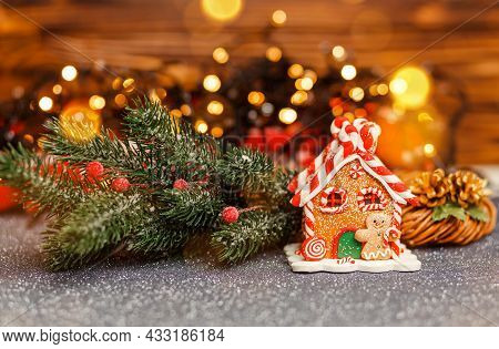 Homemade Gingerbread House In Living Room. Defocused Lights Of Christmas Tree. Morning In The Bright