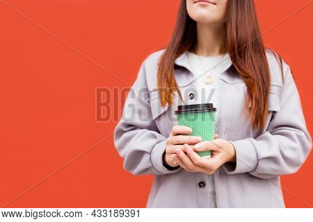 Young Caucasian Woman Holding Disposable Blue Coffee Cup. Focus On Cup And Hand. Drinking Coffee Con