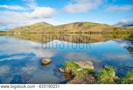 Spectacular View Of Lake Hayes One Of The Most Photographed Lake In New Zealand, Reflecting The Maje